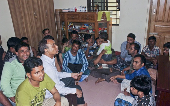 Men rescued from the buildings with the militant den sit together in a room..Photo: ISPR