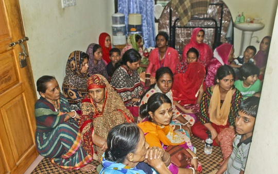 Women wait in a separate room as the commando operation continues.Photo: ISPR