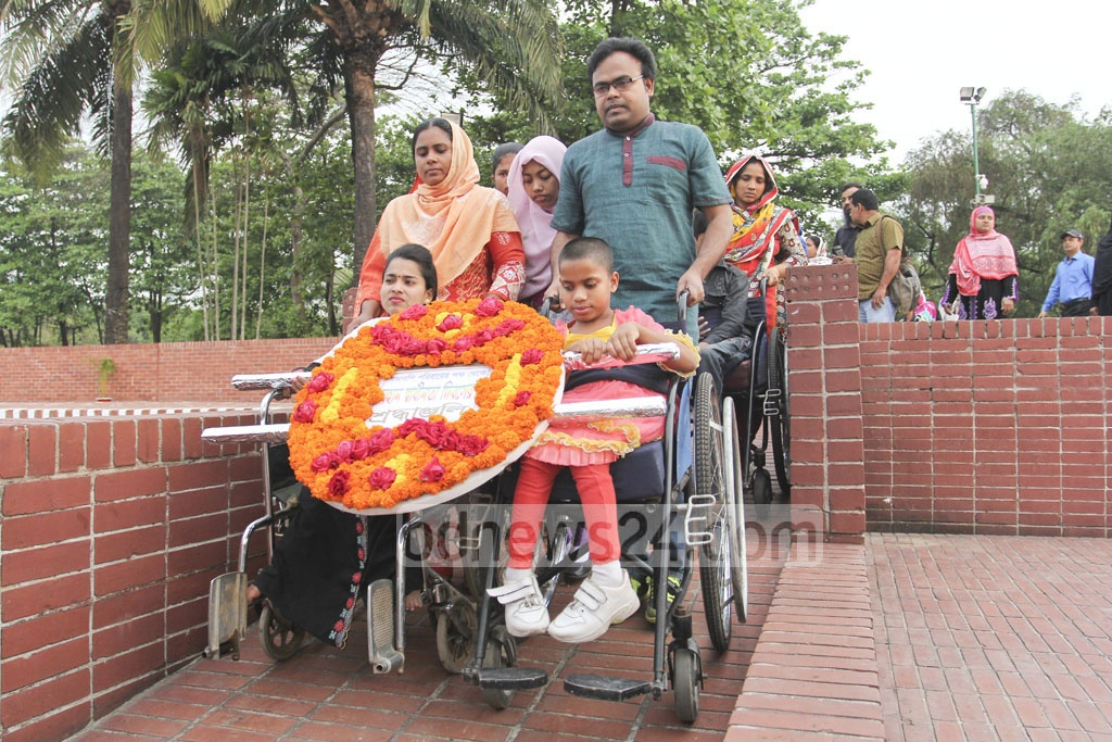 The physically challenged join a procession to pay tribute to martyrs of the Liberation War on Independence Day. Photo: asif mahmud ove