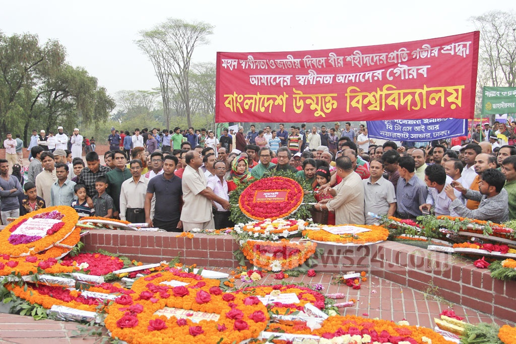 People of all walks of life make their way to National Memorial at Savar to pay tribute to martyrs of the 1971 Liberation War on Independence Day on Sunday. Photo: asif mahmud ove