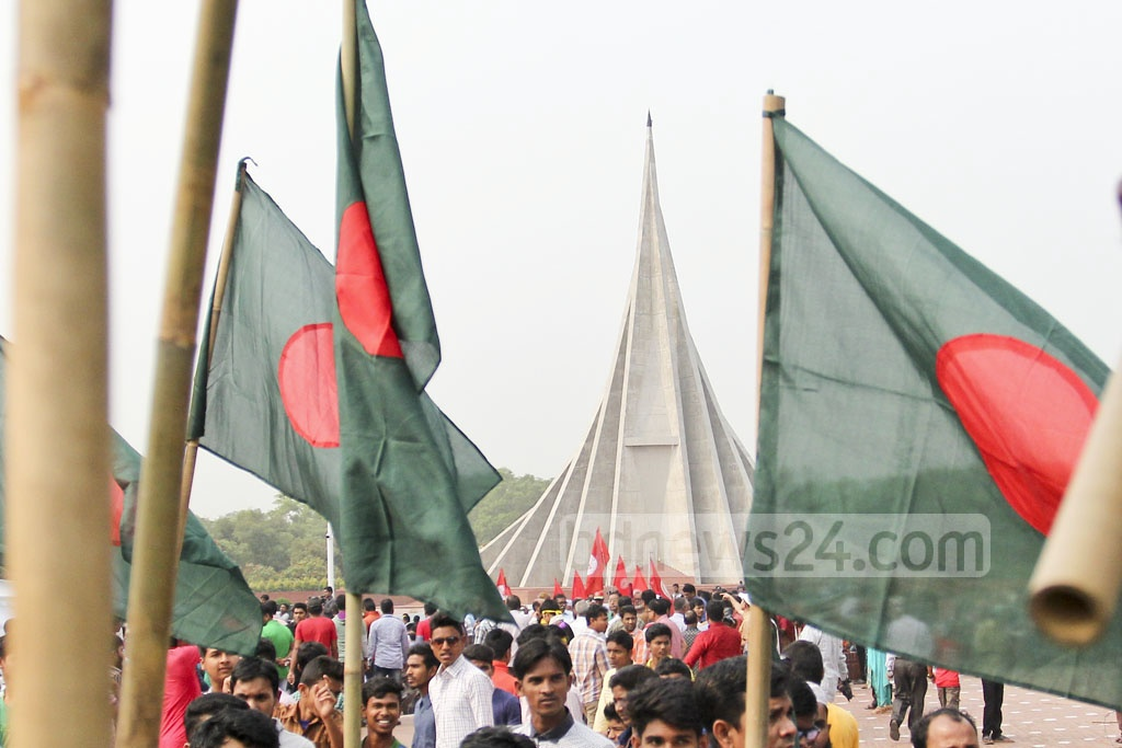 People from all walks of life, holding national flags, throng the National Memorial at Savar to pay tribute to martyrs on Independence Day, Sunday. Photo: asif mahmud ove