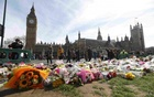 Floral tributes are seen in Parliament Square, following the attack in Westminster earlier in the week, in London, Britain Mar 25, 2017. Reuters