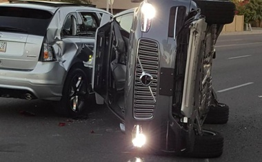 A self-driven Volvo SUV owned and operated by Uber Technologies Inc. is flipped on its side after a collision in Tempe, Arizona, US on Mar 24, 2017. Reuters