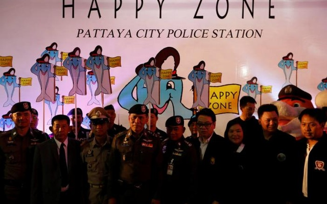 Policemen dance during the launch of the 'Happy Zone' program aiming to improve the image of the city in Pattaya, Thailand March 25, 2017. Reuters