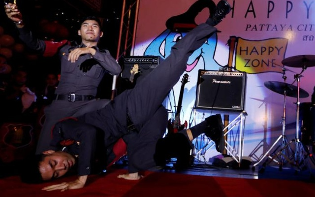 Policemen stand during the launch of the 'Happy Zone' program aiming to improve the image of a city in Pattaya, Thailand March 25, 2017. Reuters