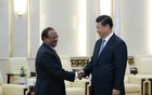 Chinese President Xi Jinping (R) shakes hands with India's National Security Adviser Ajit Doval at the Great Hall of the People in Beijing in this September 9, 2014 file photo. Reuters