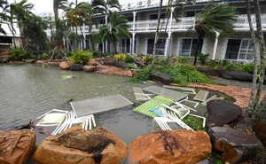 Outdoor furniture lies in a pool at a motel as Cyclone Debbie hits the northern Queensland town of Airlie Beach, located south of Townsville in Australia, March 28, 2017. Reuters