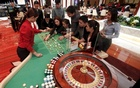 Casino dealer trainees practise on a roulette table inside Solaire Casino in Pasay city, Metro Manila, Philippines, March 27, 2015. Reuters