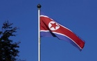 A North Korean flag flies on a mast at the Permanent Mission of North Korea in Geneva Oct 2, 2014. Reuters