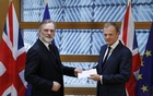 Britain's permanent representative to the European Union Tim Barrow delivers British Prime Minister Theresa May's Brexit letter in notice of the UK's intention to leave the bloc under Article 50 of the EU's Lisbon Treaty to EU Council President Donald Tusk in Brussels, Belgium March 29, 2017. Reuters