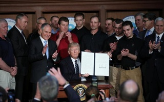 U.S. President Donald Trump holds up an executive order on 'energy independence,' eliminating Obama-era climate change regulations, during a signing ceremony at the Environmental Protection Agency (EPA) headquarters in Washington, U.S., March 28, 2017. Reuters