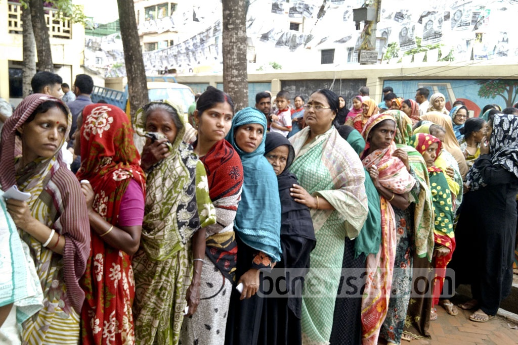 Women line up to cast their votes at the Modern School polling centre during the Comilla City Corporation elections on Thursday.