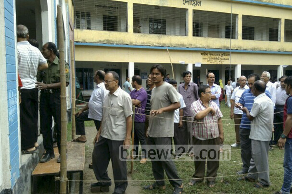 Voters wait in line at the Farida Campus voting centre to cast their ballots during the Comilla City Corporation elections on Thursday.