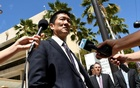 Hawaii Attorney General Douglas Chin talks to the media at the US District Court Ninth Circuit after seeking an extension after filing an amended lawsuit against President Donald Trump's new travel ban in Honolulu, Hawaii, Mar 29, 2017. Reuters