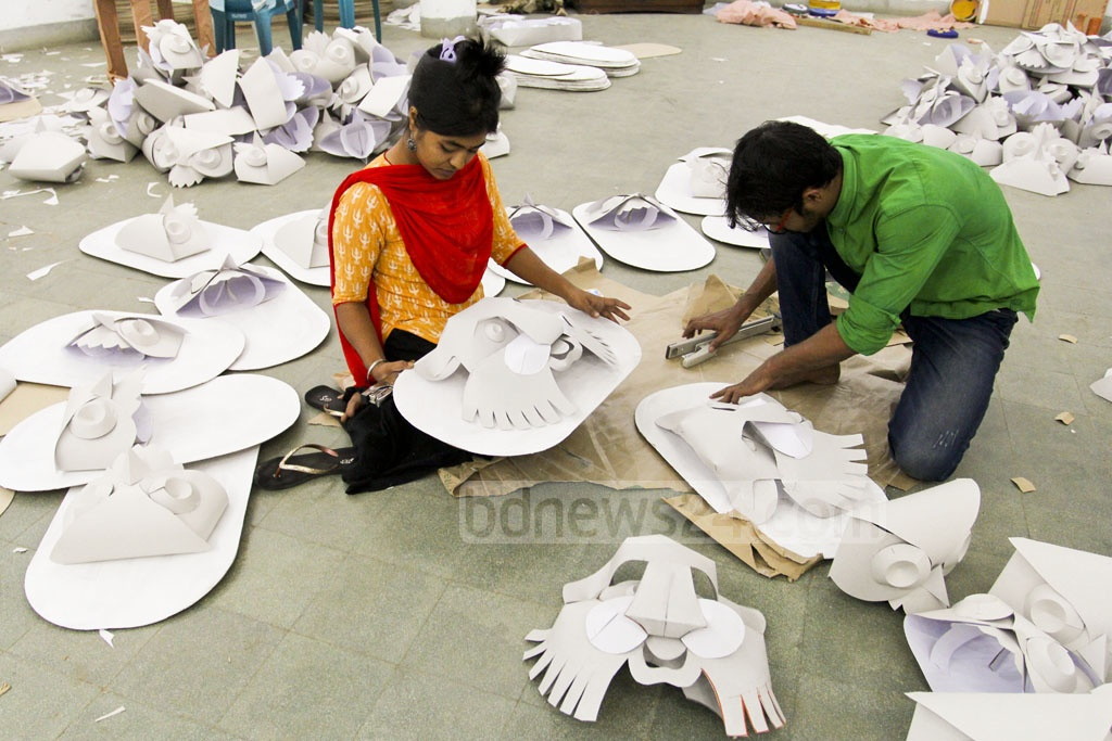 Students of Dhaka University's Faculty of Fine Arts are busy making masks to be used in Bangla New Year celebrations.