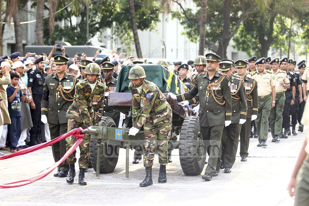 The body of RAB Intelligence Wing Director Lt Col Abul Kalam Azad, who died after being injured in blasts in Sylhet, is brought to Banani Military Graveyard from RAB Headquarters for burial with due military honour on Friday.