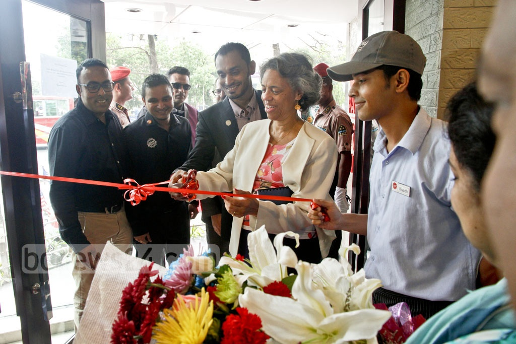 US Ambassador Marcia Bernicat attends the inauguration ceremony of American burger chain Johnny Rockets, which opened its first branch in Dhaka on Saturday. Photo: tanvir ahammed