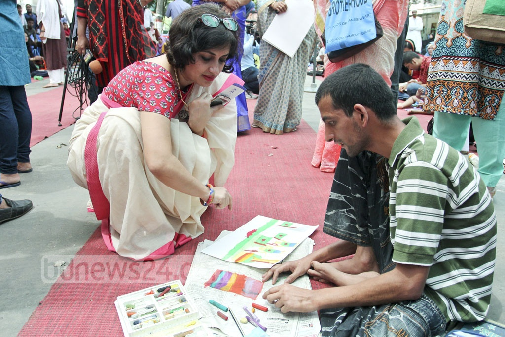 An autistic child has the special talent that is shown through their paintings at the art camp organised at the Bangabandhu Sheikh Mujib Medical University on the occasion of World Autism Awareness Day on Saturday. Photo: asif mahmud ove