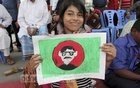 An autistic child shows the Bangladesh's flag and the person who brought it for us at the art camp organised at the Bangabandhu Sheikh Mujib Medical University on the occasion of World Autism Awareness Day on Saturday. Photo: asif mahmud ove