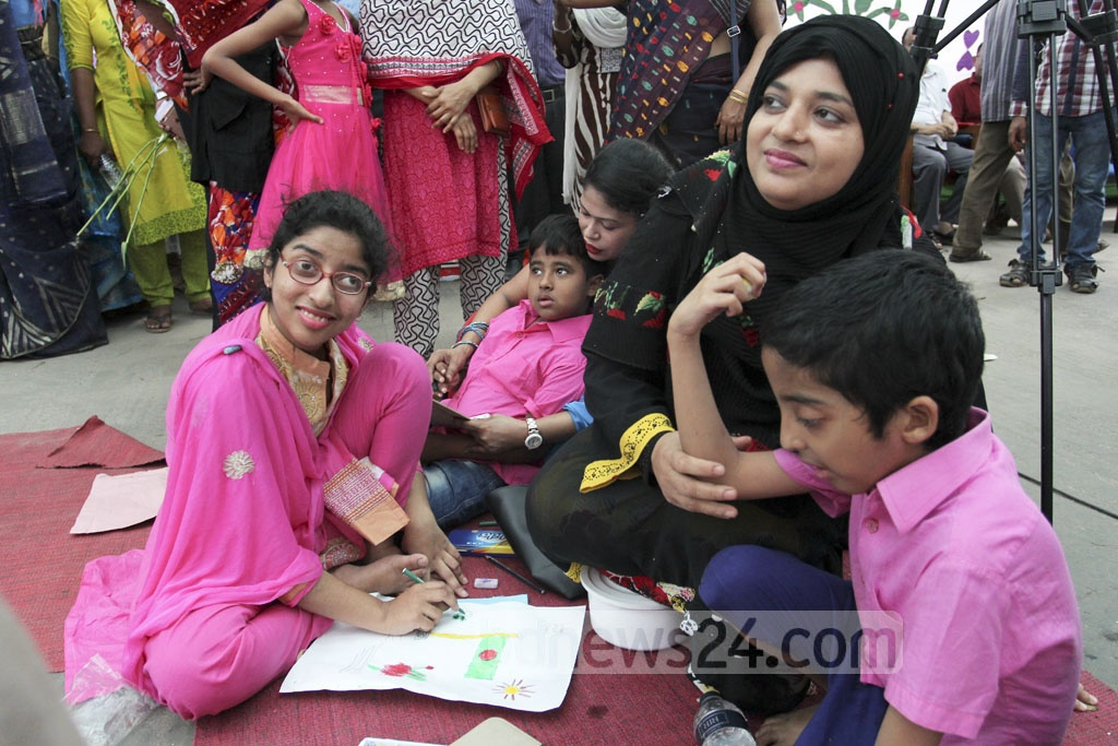 Autistic children are showing their painting skills at the art camp organised at the Bangabandhu Sheikh Mujib Medical College on the occasion of World Autism Awareness Day on Saturday. Photo: asif mahmud ove
