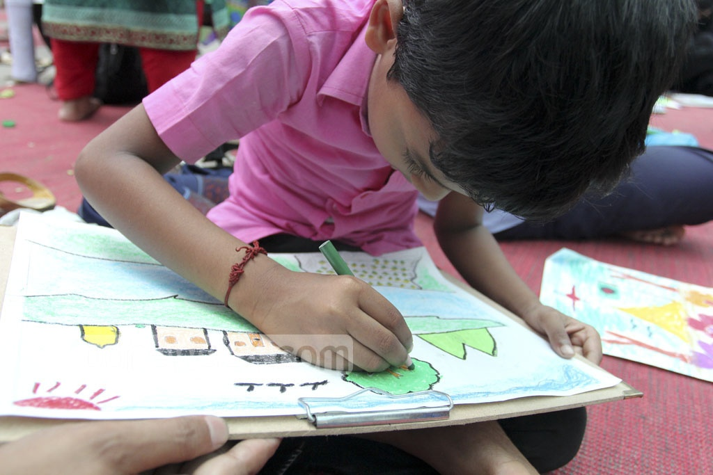 An autistic child is showing his version of rural Bangladesh at the art camp organised at the Bangabandhu Sheikh Mujib Medical University on the occasion of World Autism Awareness Day on Saturday. Photo: asif mahmud ove