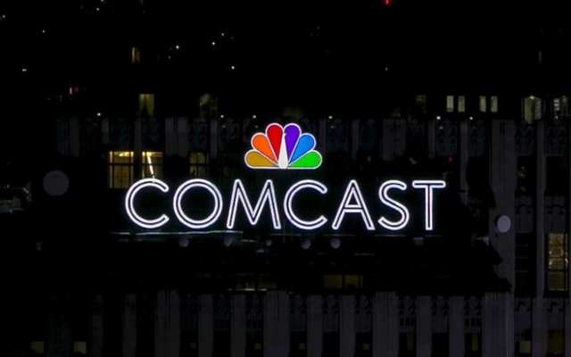 The NBC and Comcast logo are displayed on top of 30 Rockefeller Plaza, formerly known as the GE building, in midtown Manhattan in New York Jul 1, 2015. Reuters