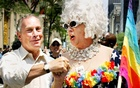 New York Mayor Michael Bloomberg greets Gilbert Baker as they take part in the annual Gay Pride parade in New York City, Jun 30, 2002. Reuters