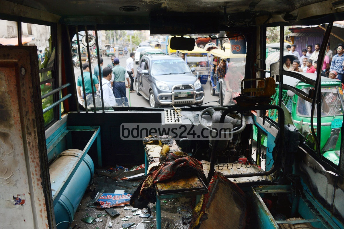 This minibus was vandalised and set on fire by an angry mob after it injured a student on Chittagong's Sirajuddoula Chandanpura Road. Photo: suman babu