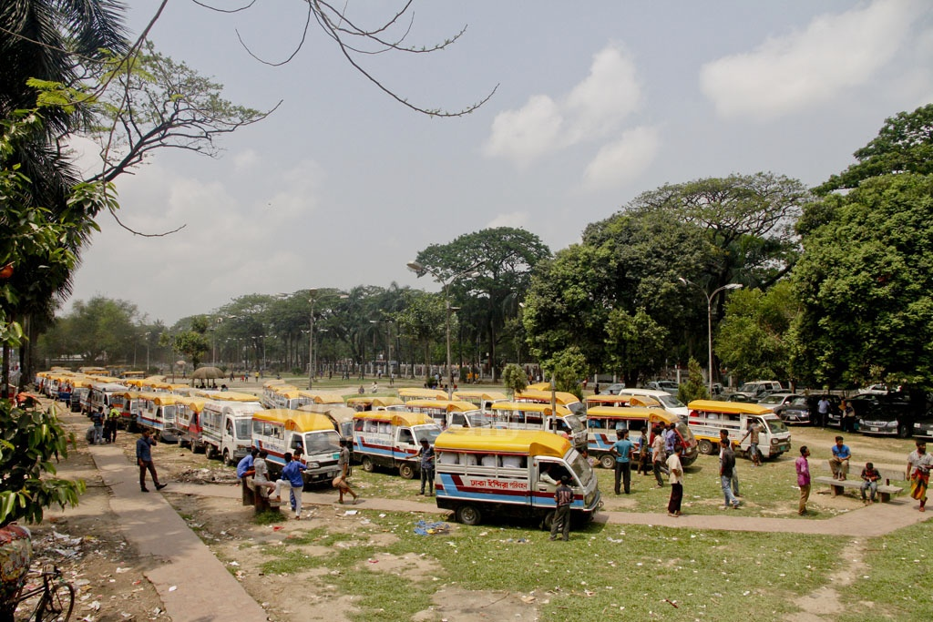 Legunas parked in rows take up almost all the space of Dhaka's Farmgate Park which is now being used as a parking zone for vehicles. Photo: tanvir ahammed