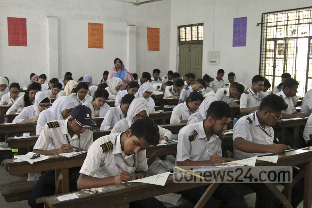 Students take the HSC exams at an examination hall at the Dhaka College centre on the first day of exams on Sunday. Photo: asif mahmud ove