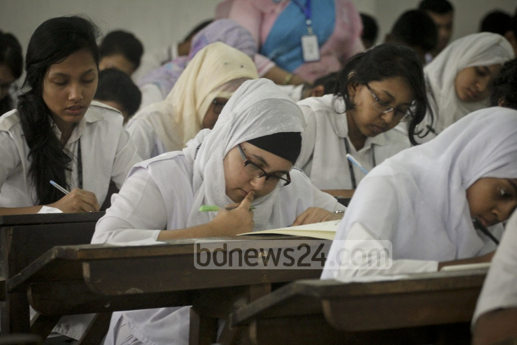 Students take the HSC examination at the Dhaka College centre on Sunday, the first day of the exams. Over 1.2 million students are taking the exam this year. Photo: asif mahmud ove