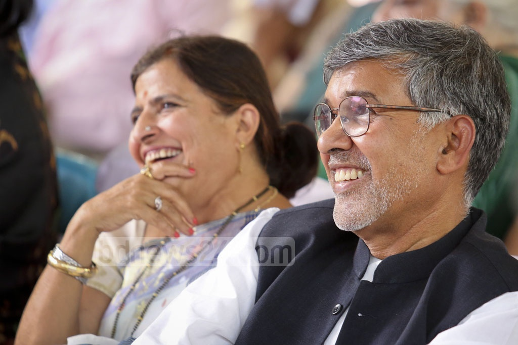 Nobel Peace Laureate Kailash Satyarthi and his wife Sumedha Kailash are seen among the guests at the launching ceremony of his new initiative titled '100 Million for 100 Million' in Bangladesh for education-deprived and disadvantaged people at the St Joseph High School on Sunday. Photo: asaduzzaman pramanik