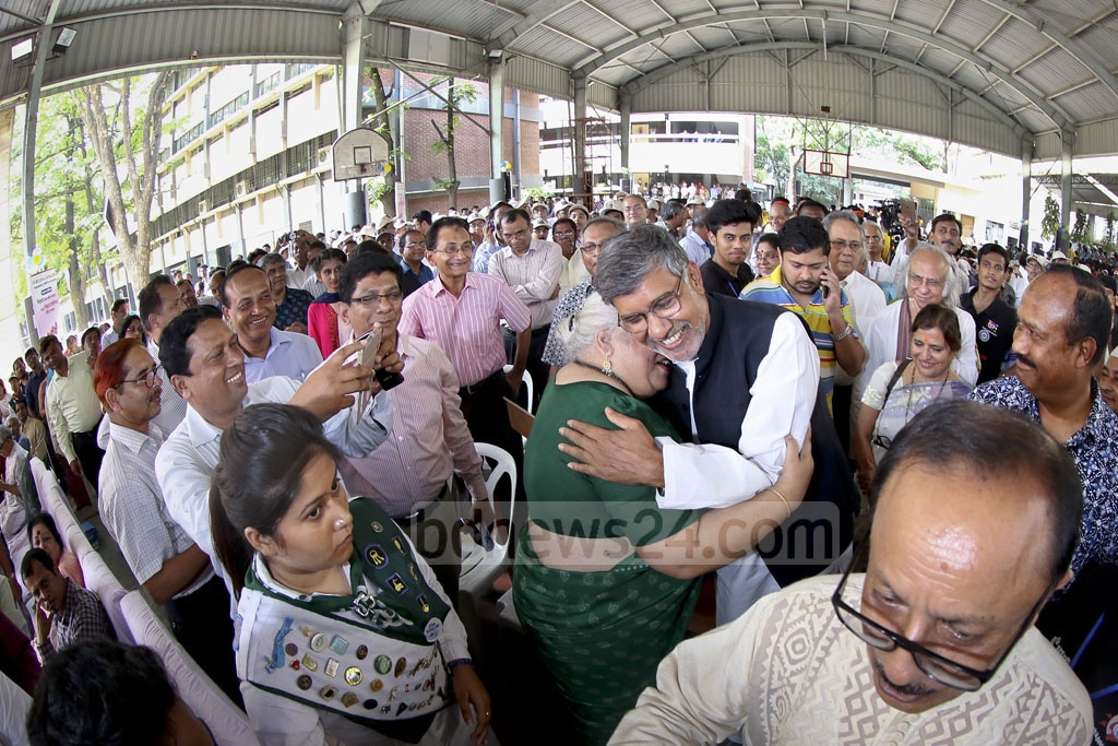 Nobel Peace Laureate Kailash Satyarthi is hugging rights activist Aroma Dutta during the launching ceremony of his new initiative titled '100 Million for 100 Million' in Bangladesh for education-deprived and disadvantaged people at the St Joseph High School on Sunday. Photo: asaduzzaman pramanik