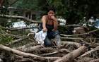 A woman is seen on a destroyed street after flooding and mudslides caused by heavy rains in Mocoa, Colombia Apr 2, 2017. Reuters