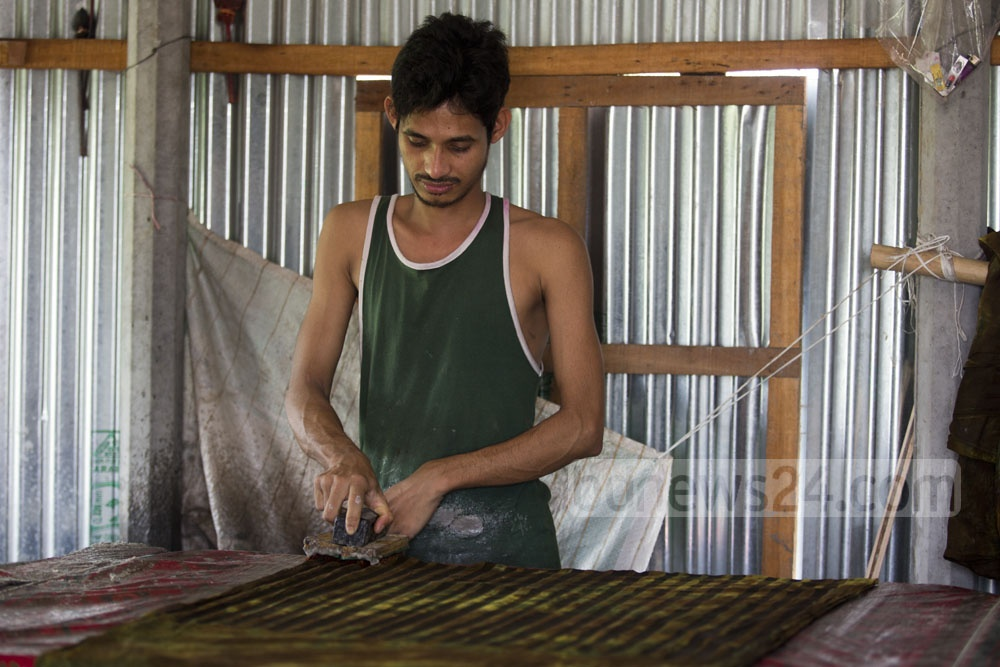 Waxing before fabric printing at Narayanganj's Bunty Village. Photo: mostafigur rahman