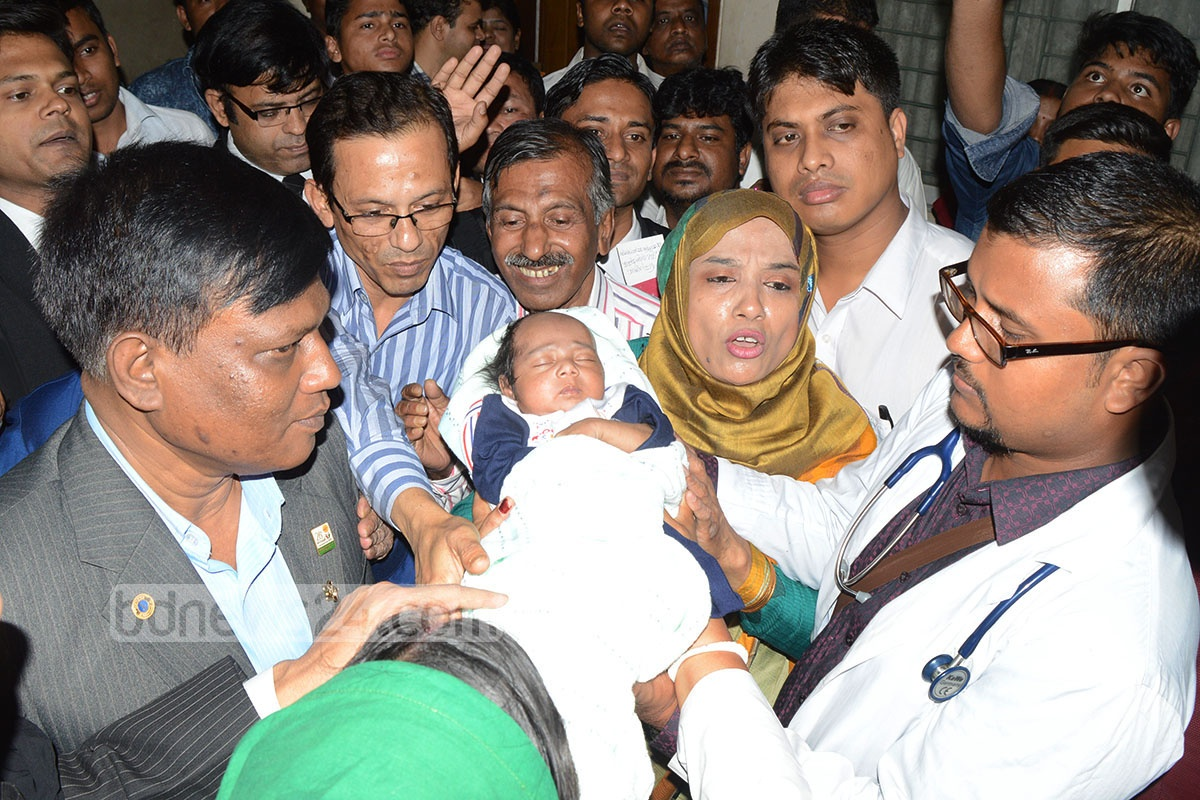Dr Zakirul Islam and Shakila Akter finally on Wednesday gain the custody of 'Ekush,' an infant who was recovered from a heap of waste on Feb 21 this year. Chittagong Additional Metropolitan Sessions Judge Jannatul Ferdous handed over the newborn to the couple. Photo: suman babu