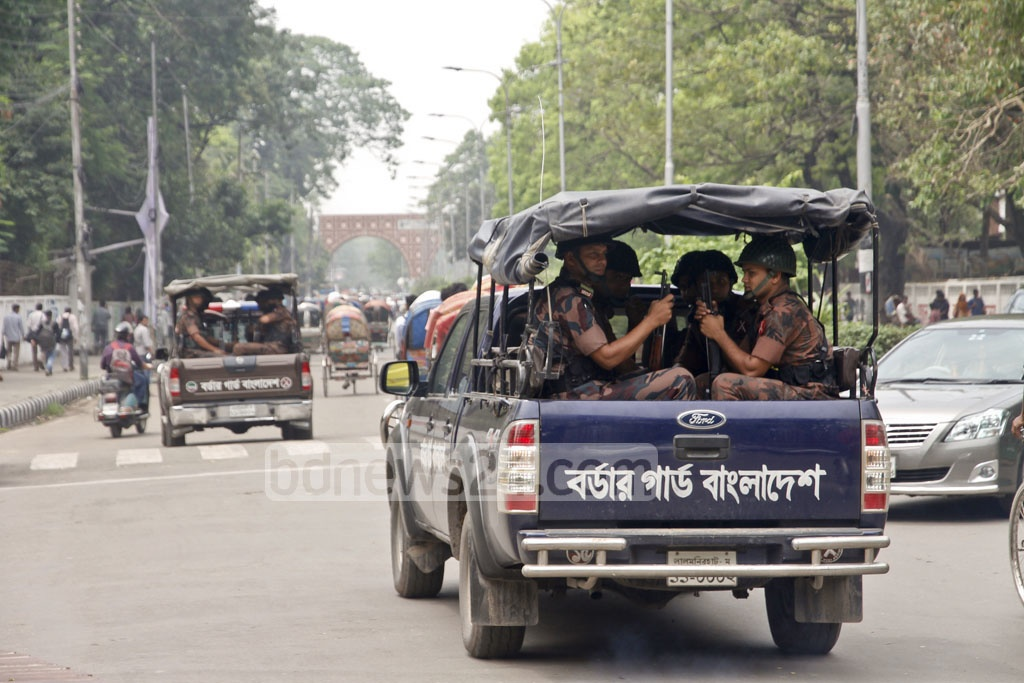 Border guards patrol the Dhaka University area as part of the security measures in place for the Islamic Foundation Conference in the capital on Thursday. Photo: tanvir ahammed
