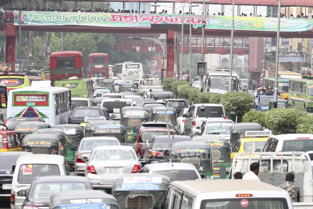 Traffic congestion is seen at Farmgate due to security measures in place for the Islamic Foundation Conference in Dhaka's Suhrawardy Udyan on Thursday. Photo: abdul mannan