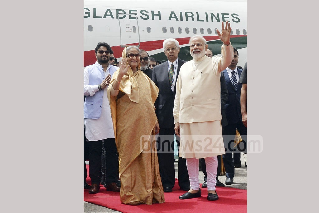 A warm welcome - Indian PM Narendra Modi receives PM Sheikh Hasina after she arrived at New Delhi's Palam air base for a four-day state tour on Friday. Photo: PID