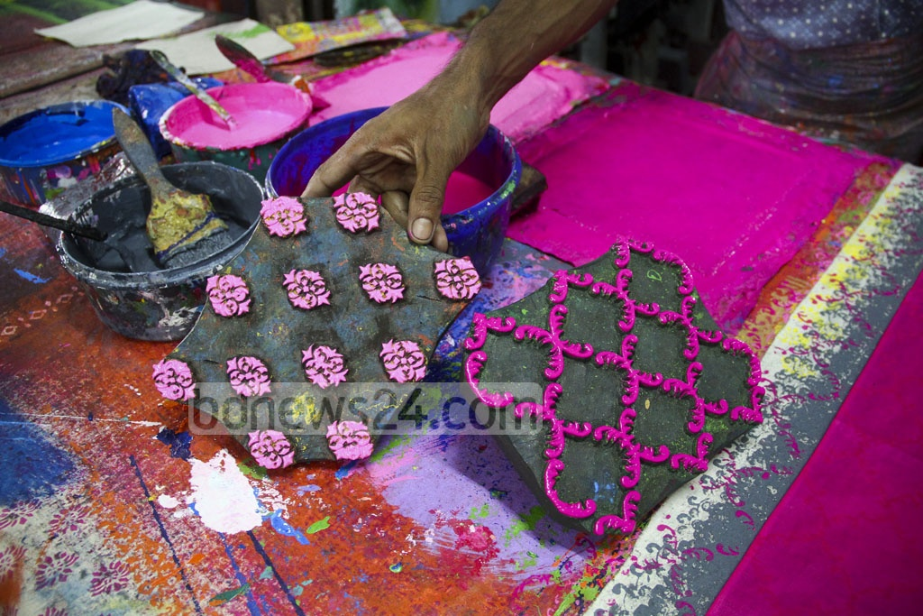 A boutique artist holds his design before bdnews24.com camera to show what they are doing for this Pahela Baishakh. The picture is taken from the capital's New Market area. Photo: abdul mannan