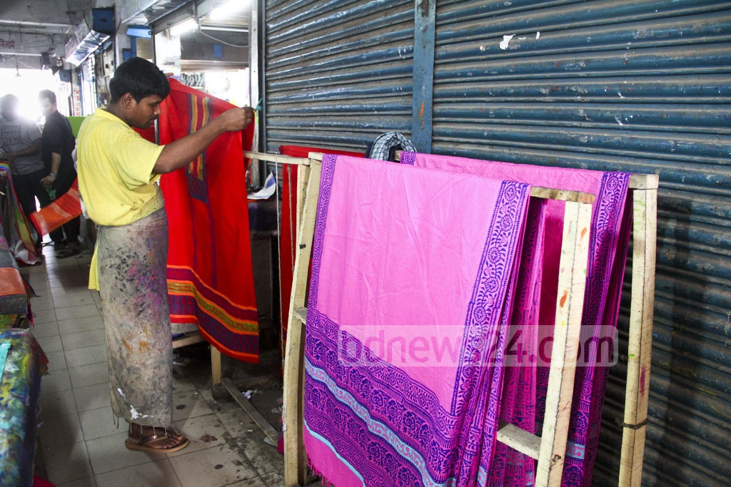 Finished boutique works are put out to the sun for drying. Photo: abdul mannan