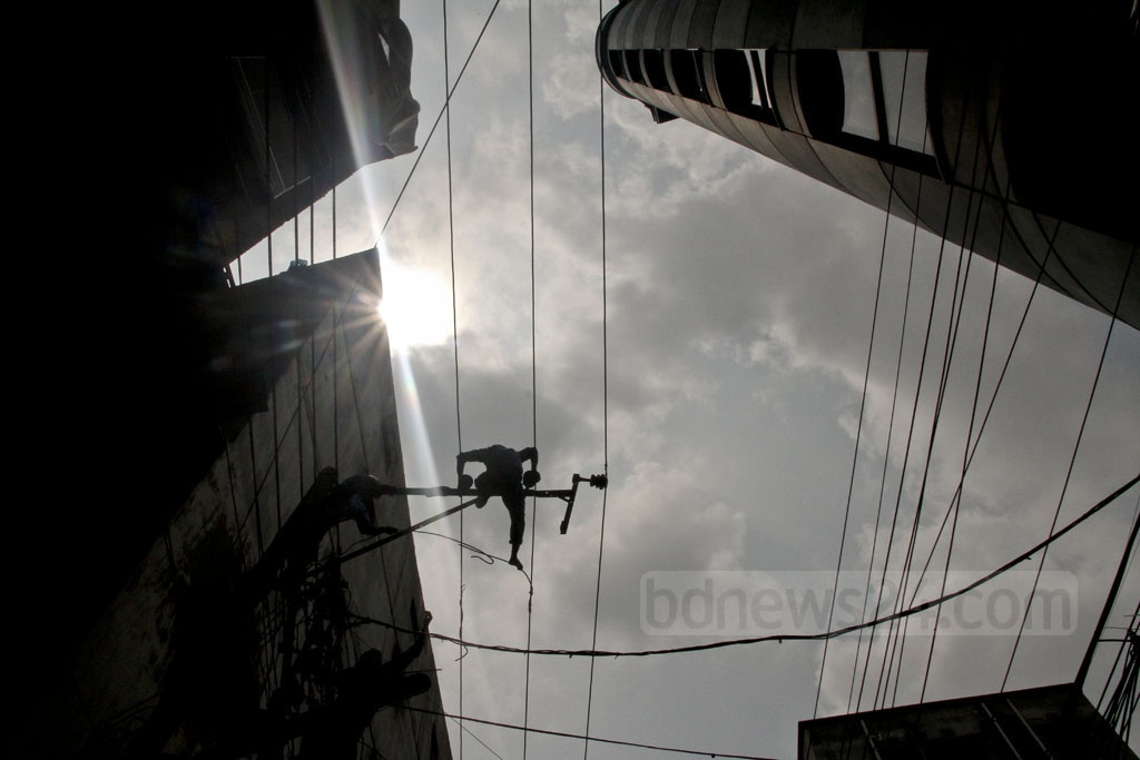 Workers are busy cutting power connections to the tanneries in the capital's Hazaribagh on Saturday.