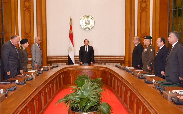 Egyptian President Abdel Fattah al-Sisi (centre) stands and observes a minute of silence for the victims of the church attacks, with leaders of the Supreme Council of the Armed Forces and the Supreme Council for Police to discuss developments in the security situation, Cairo, Egypt, April 9, 2017. The Egyptian Presidency/Handout via Reuters