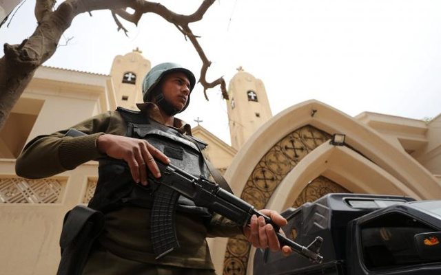 An armed policeman secures the Coptic church that was bombed on Sunday in Tanta, Egypt April 10, 2017. Reuters
