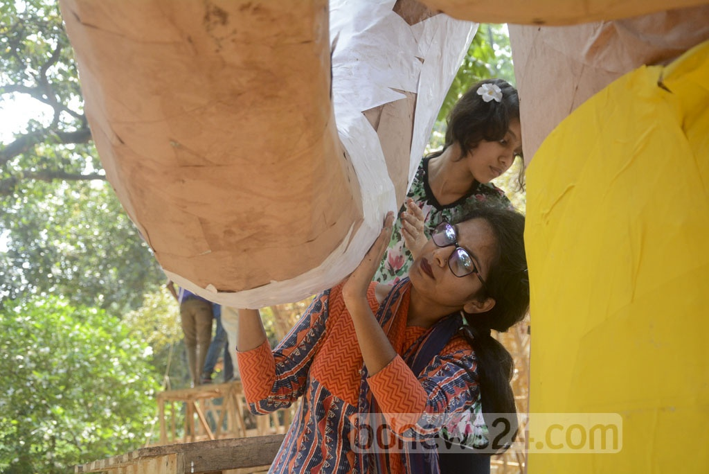 Students of the Institute of Fine Arts make final preparations on Thursday ahead of Pahela Baishakh celebrations.