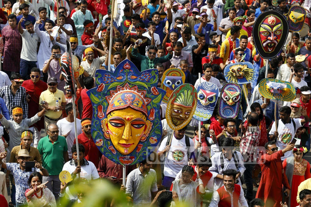 The 'Mangal Shobhajatra' procession on Pahela Baishakh calls upon Bangladeshis to fight back dark forces and evil practices of extremism. Photo: mostafigur rahman