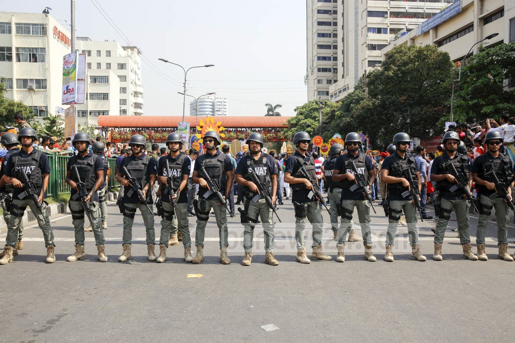 Law enforcers stand guard during the 'Mangal Shobhajtra' procession. Photo: mostafigur rahman