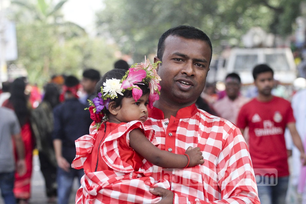 A child joins Bangla New Year celebrations on his father's lap. Photo: asif mahmud ove