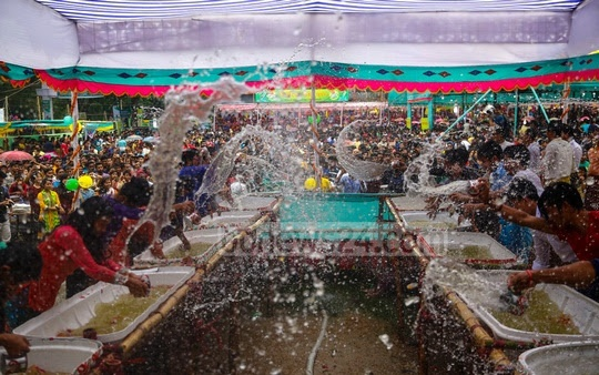 Marma tribal girls are splashing water as part of the Sangrai water festival organised to celebrate the new year at Betbunia High School at Kawkhali Upazila in Rangamati on Sunday. Photo: mostafigur rahman