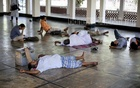 File Photo: People rest at the Dhaka University Central Mosque during a heatwave on Apr 17, 2017.